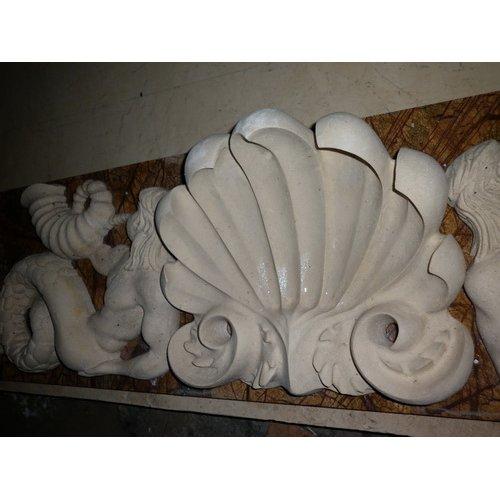 Декоративный элемент для облицовки камина